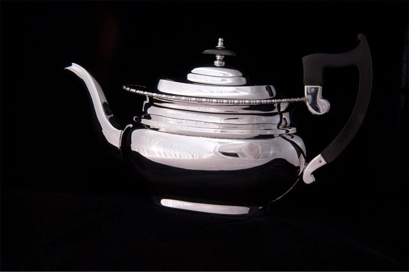 polished silver kettle